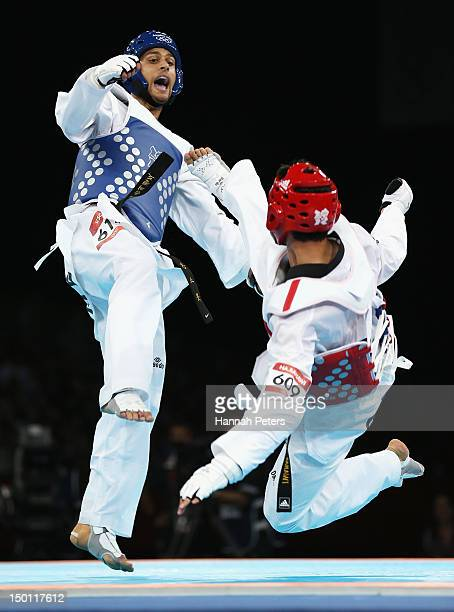 Nesar Ahmad Bahawi of Afghanistan competes against Vaughn Scott of New Zealand in the Men's 80kg Taekwondo Repechage on Day 14 of the London 2012...
