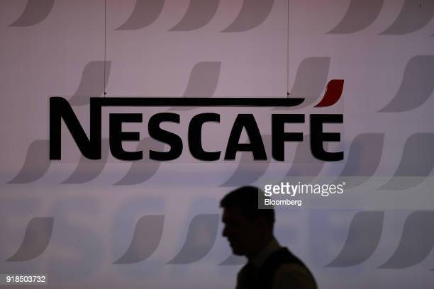 A Nescafe logo stands on display at the Nestle SA headquarters in Vevey Switzerland on Thursday Feb 15 2018 Since taking over about a year ago chief...