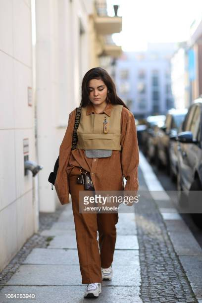 Neslihan Degerli wearing a Dickies trousers Daily Paper jacket Chanel shoes Celine small bag Fendi bagpack and a shirt from Wrangler on November 06...