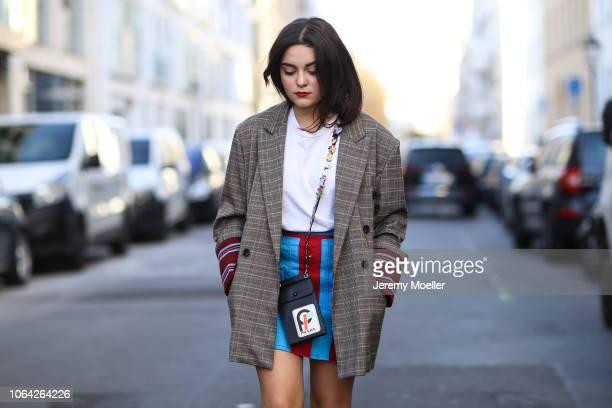 Neslihan Degerli wearing a Prada skirt and bag Louis Vuitton Archlight shoes Maison Margiela shirt and a Tara by Motion Blazer on November 06 2018 in...