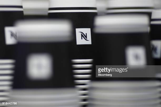 Nespresseo cups stand stacked ahead of a news conference announcing the company's full year results in Vevey Switzerland on Thursday Feb 15 2018...