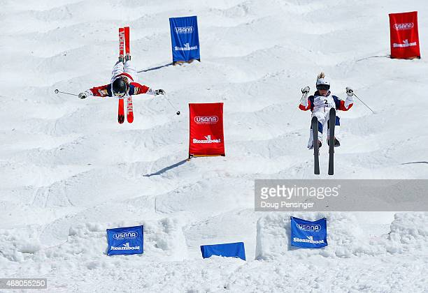 Nessa Dziemian skis to victory against second place finisher K C Oakley as they go airborne off the last jump in the ladies' final of dual moguls at...