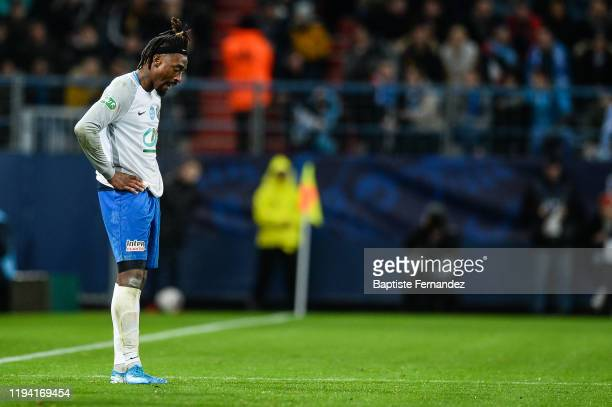 Nessemon William SEA of Granville reacts dejected after he received a red card during the French Cup Soccer match between US Granville and Olympique...