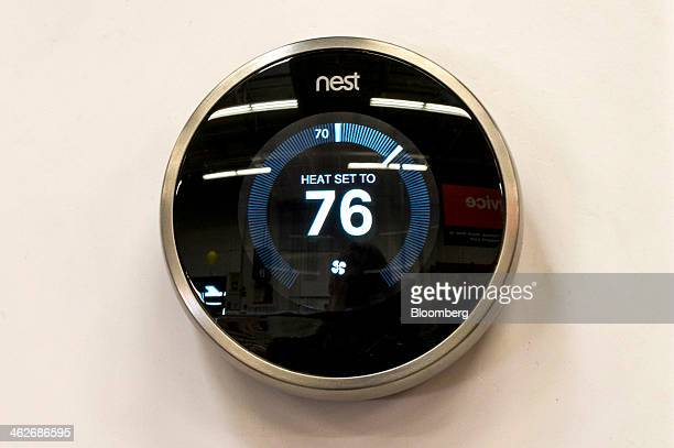 A Nest Labs Inc digital thermostat is displayed at a Home Depot Inc store in Emeryville California US on Tuesday Jan 14 2014 Google Inc after...