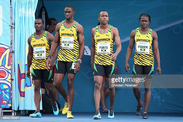 Nesta Carter, Kemar Bailey-Cole, Julian Forte and Andrew Fisher of Jamaica are introduced to the Men's 4x100 metres relay during day two of the IAAF...