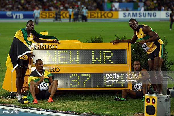 Nesta Carter, Michael Frater, Yohan Blake and Usain Bolt of Jamaica celebrate victory and a new world record in the men's 4x100 metres relay final...