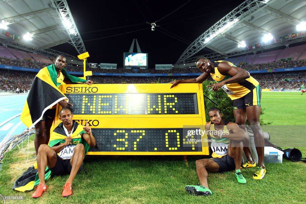 Nesta Carter, Michael Frater, Yohan Blake and Usain Bolt of Jamaica celebrate victory and a new world record in the men's 4x100 metres relay final during day nine of 13th IAAF World Athletics Championships at Daegu Stadium on September 4, 2011 in Daegu, South Korea.