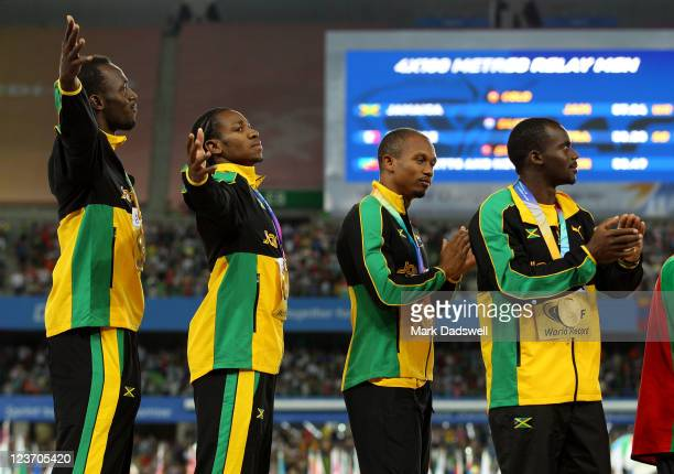 Nesta Carter, Michael Frater,Yohan Blake and Usain Bolt of Jamaica pose with their gold medals during the medal ceremony forthe men's 4x100 metres...