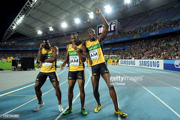 Nesta Carter, Yohan Blake and Usain Bolt of Jamaica celebrate victory and a new world record in the men's 4x100 metres relay final during day nine of...