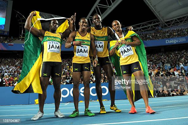 Nesta Carter, Yohan Blake, Usain Bolt and Michael Frater of Jamaica celebrate victory and a new world record in the men's 4x100 metres relay final...
