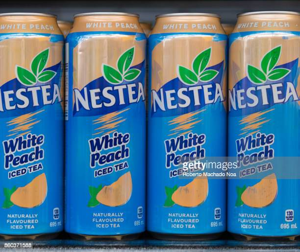 Nestea iced tea cans on a store shelf they are white peach flavored The brand is a joint venture between The CocaCola Company and Nestlé Nestle owns...