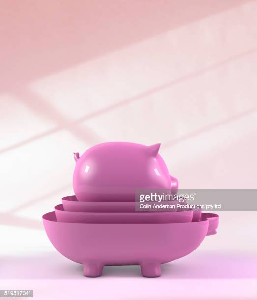 Nesting purple piggy banks on counter
