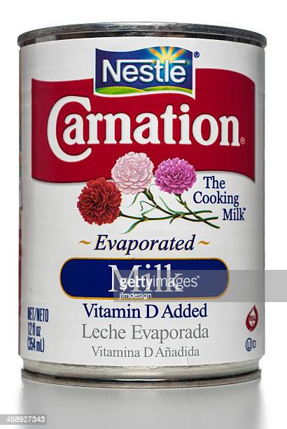 nestlé carnation evaporated milk can - carnation flower stock pictures, royalty-free photos & images
