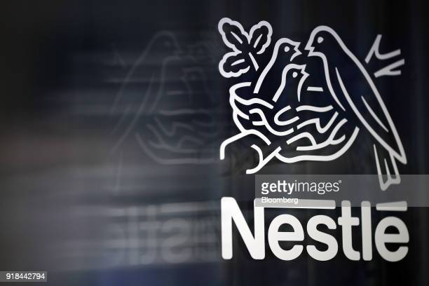 A Nestle birds nest logo is displayed on a glass door ahead of a news conference announcing the company's full year results in Vevey Switzerland on...