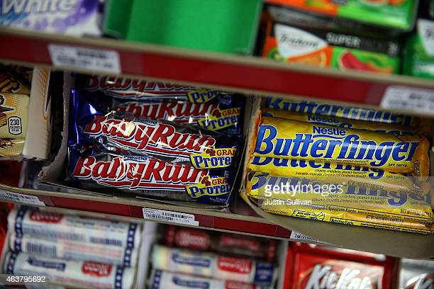 Nestle Butterfinger and Baby Ruth candy bars are displayed on a shelf at a convenience store on February 18 2015 in San Francisco California Nestle...
