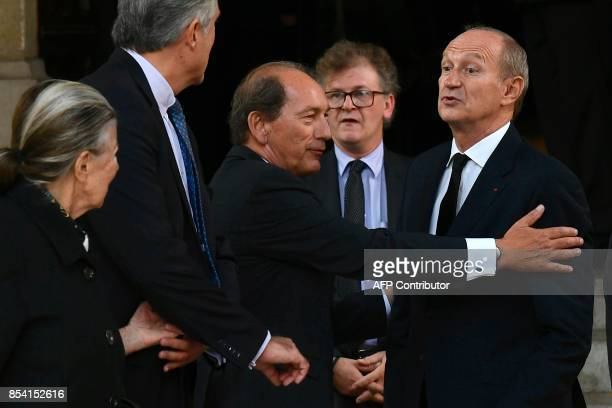 Nestle CEO Paul Bulcke talks with L'Oreal Chairman JeanPaul Agon as they leave after attending the funeral of L'Oreal heiress Liliane Bettencourt on...