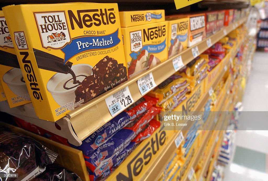 Nestle chocolate products are displayed on the shelves of a