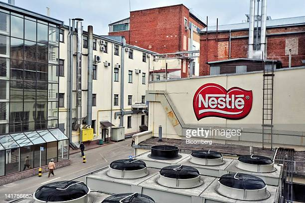 A Nestle SA logo sits on a wall at the company's Svitoch factory in Lviv Ukraine on Thursday March 22 2012 Switzerland's Nestle SA in 2012 is...