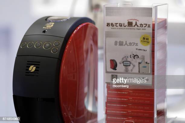 A Nestle SA Nescafe Gold Blend Barista 50 coffee machine left stands on a counter during a media preview of the humanless cafe inside the Nescafe...
