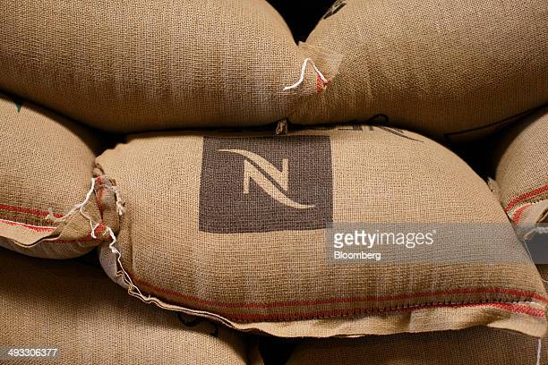 Nestle SA's Nescafe logo sits on a sack of coffee beans at the Molenbergnatie NV coffee and cocoa handling terminal at the Port of Antwerp in Antwerp...