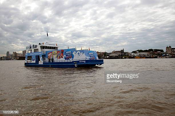 Nestle SA's supermarket boat sails in the Guajara Bay away from the city of Belem Brazil background and towards it's destination of Barcarena on...