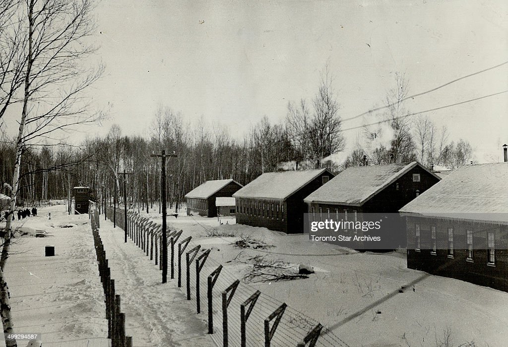 Nestled in snow; Double wire fencing features the camp-like atmosphere of the internment centre at P... : News Photo