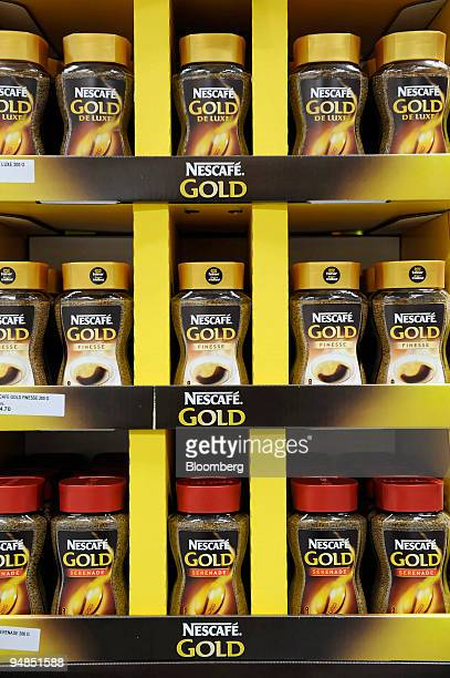 Nestle's Nescafe on display in a supermarket in Biel Switzerland on Monday Nov 17 2008 Nestle SA has lured customers from rivals Unilever by...