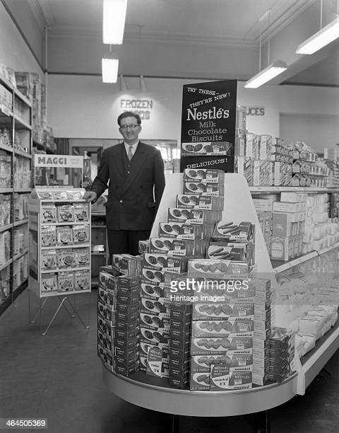 Nestle's shop display Mexborough South Yorkshire 1959 In this advert to promote Nestle's biscuits Mr John Clayton stands beside the dispay in his...