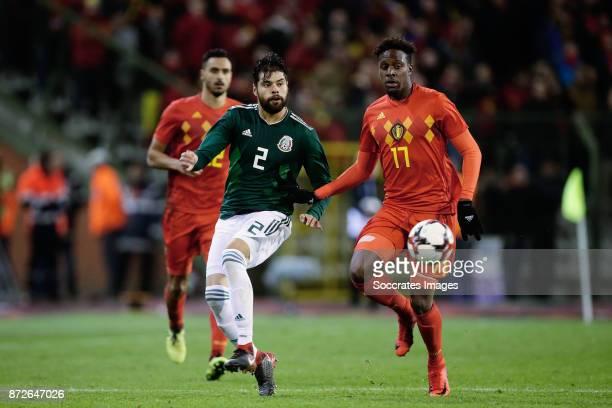 Nestor Araujo of Mexico Divock Origi of Belgium during the International Friendly match between Belgium v Mexico at the Koning Boudewijnstadion on...