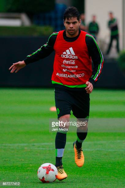 Nestor Araujo of Mexico drives the ball during a Mexico's National Team training session ahead of the Qualifier match against Trinidad Tobago at CAR...