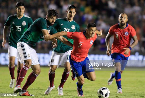 Nestor Araujo of Mexico fights for the ball with Alexis Sanchez of Chile during the international friendly match between Mexico and Chile at La...