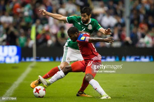 Nestor Araujo of Mexico fights for the ball with Amador Cooper of Panama during the match between Mexico and Panama as part of the FIFA 2018 World...
