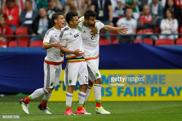 Nestor Araujo of Mexico national team celebrates his goal with teammates Hector Moreno and Hirving Lozano during the Group A FIFA Confederations Cup...