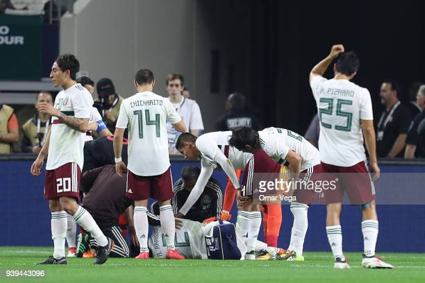 Nestor Araujo of Mexico receives medical assistance after being injured on his left knee during the international friendly match between Mexico and...