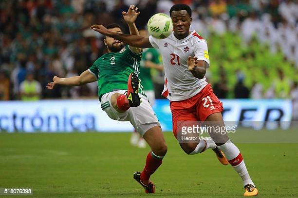 Nestor Araujo of Mexico struggles for the ball with Cyle Larin of Canada during the match between Mexico and Canada as part of the FIFA 2018 World...