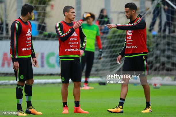 Nestor Araujo of Mexico talks with teammates Hector Moreno and Diego Reyes during a Mexico's National Team training session ahead of the Qualifier...