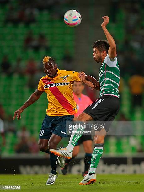 Nestor Araujo of Santos and Duvier Riascos of Morelia fight for the ball during a match between Santos Laguna and Morelia as part of 12th round...