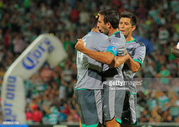 Nestor Araujo of Santos celebrates with teammates after scoring the third goal of his team during a 7th round match between Santos Laguna and Pumas...