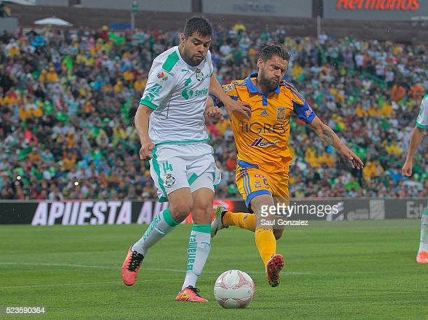 Nestor Araujo of Santos drives the ball as he is marked by Rafael Sobis of Tigres during the 15th round match between Santos Laguna and Tigres UANL...