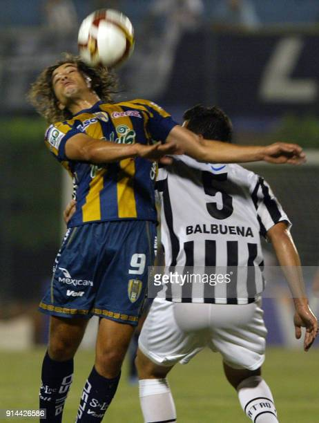 Nestor Barreiro of Mexico's San Luis jumps for a header against Edgar Balbuena of Paraguay's Libertad during their 2009 Libertadores Cup football...
