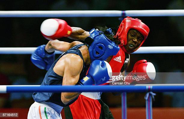 Nestor Bolum of Nigeria exchanges punches with Akhil Kumar of India in the Men's Bantam 54 kg Boxing Semi-final bout at the Melbourne Exhibition...