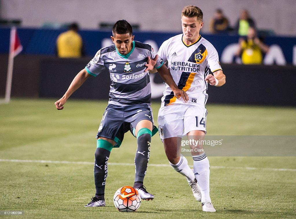 Nestor Calderon #11 of Santos Laguna battles Robbie Rogers #14 of Los Angeles Galaxy during the CONCACAF Champions League match between Santos Laguna and Los Angeles Galaxy at the StubHub Center on February 24, 2016 in Carson, California. The final score was