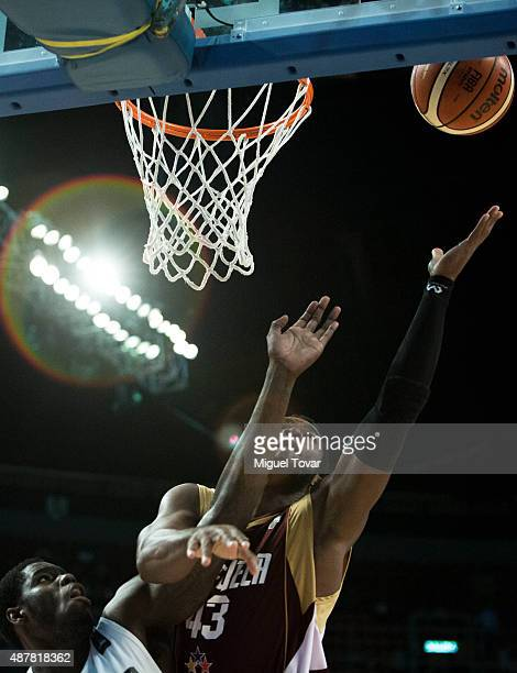 Nestor Colmenares of Venezuela goes for the basket against Anthony Bennett of Canada during a semifinals match between Canada and Venezuela as part...