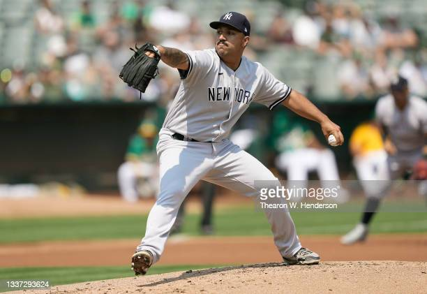 Nestor Cortes Jr. #65 of the New York Yankees pitches against the Oakland Athletics in the bottom of the first inning at RingCentral Coliseum on...