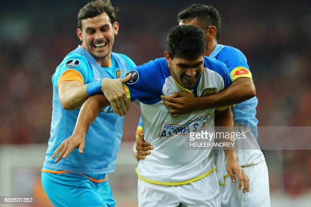 Nestor Gonzalez of Paraguay's Deportivo Capiata celebrates upon scoring against Atletico Paranaense during their Libertadores Cup football match at...