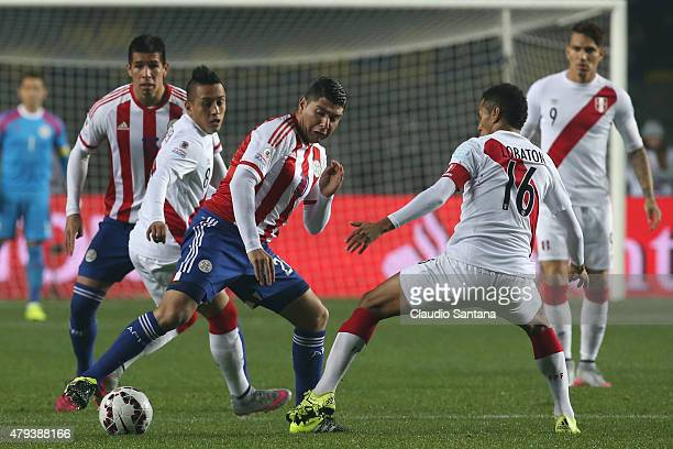 Nestor Ortigoza of Paraguay fights for the ball with Carlos Lobaton of Peru during the 2015 Copa America Chile Third Place Playoff match between Peru...