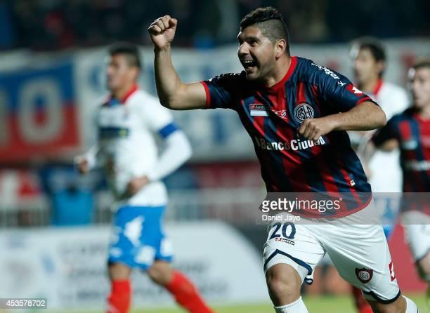 Nestor Ortigoza, of San Lorenzo, celebrates after scoring the opening goal during the second leg final match between San Lorenzo and Nacional as part...