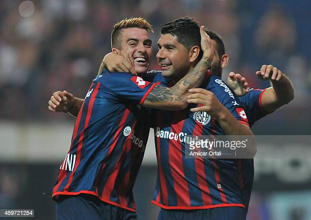 Nestor Ortigoza of San Lorenzo celebrates with his teammate Julio Buffarini after scoring the opening goal from a penalty kick during a match between...