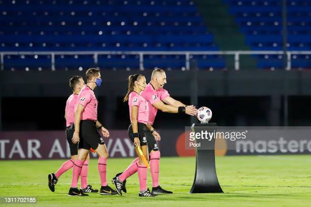 Nestor Pitana referee of of the game takes the ball prior a third round first leg match between Independiente del Valle and Gremio as part of Copa...