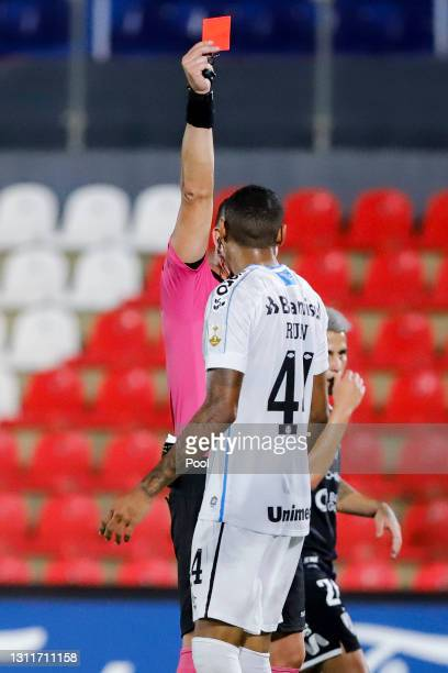 Nestor Pitana shows the red card to Ruan of Gremio during a third round first leg match between Independiente del Valle and Gremio as part of Copa...